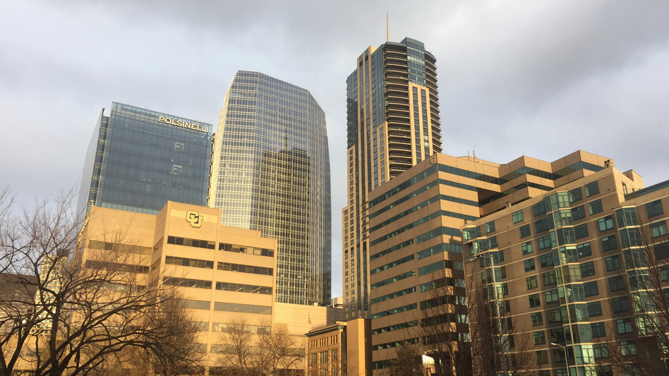 Denver's newest skyscraper (center) followed new building codes for energy efficiency. The city wants to reduce greenhouse gas emissions 80 percent by 2050. (Dan Boyce for NPR)
