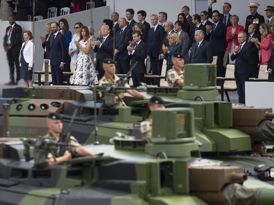 Tanks parade past President Trump, first lady Melania Trump, French President Emmanuel Macron and his wife, Brigitte Macron, during a Bastille Day parade on the Champs Elysees avenue in Paris on July 14, 2017.