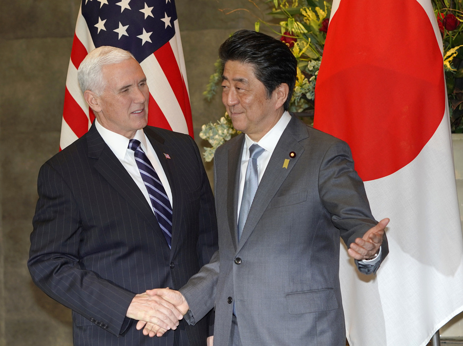 Vice President Pence is greeted by Japanese Prime Minister Shinzo Abe in Tokyo on Wednesday.