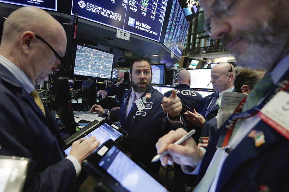 The stock market swung dramatically Wednesday, ending about where it started the day — after record losses earlier in the week. (Richard Drew/AP)