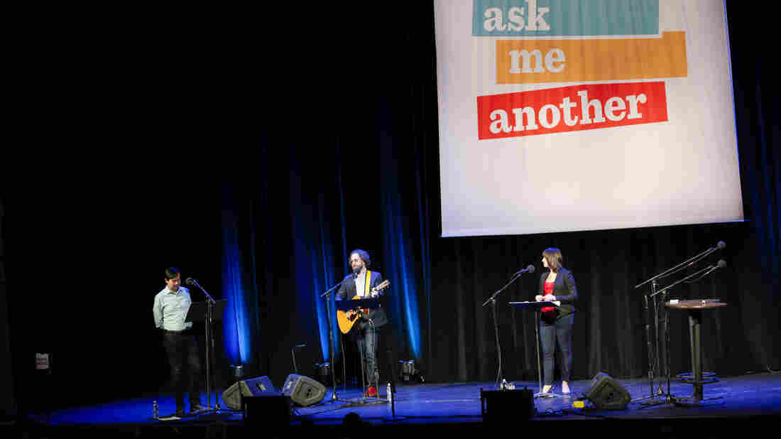 Art Chung, Jonathan Coulton, and Ophira Eisenberg at a live taping of Ask Me Another at the Warner Theatre in Washington, D.C.