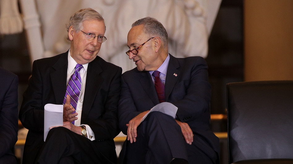 U.S. Senate Majority Leader Mitch McConnell (left) chats with Senate Minority Leader Chuck Schumer in October. The two negotiated a budget agreement that marks a major breakthrough for a Congress still reeling from a partial government shutdown last month. (Alex Wong/Getty Images)