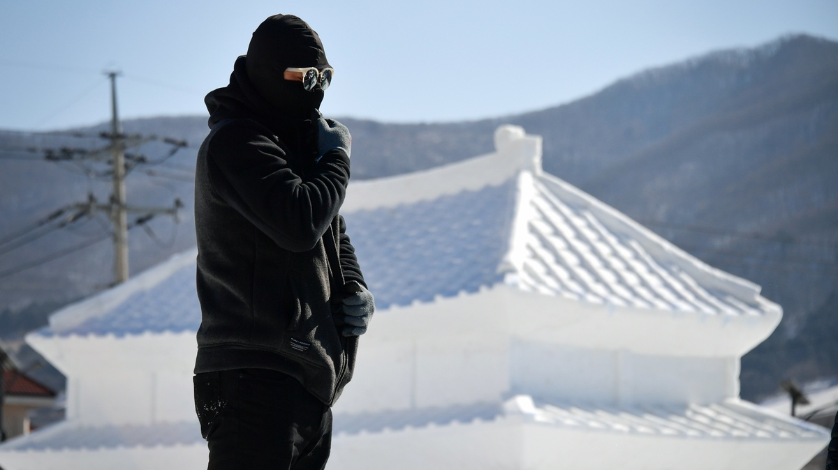 The Pyeongchang 2018 Winter Olympics Reverse A Recent Trend Of Relatively Warm Conditions At The Winter Games Here A Man Prepares To Work In Front Of An