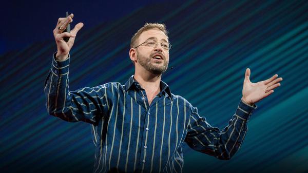 Allan Adams speaks on the TED stage.
