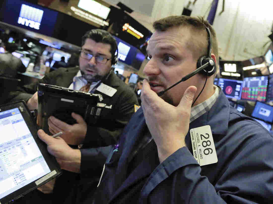 Wall St falls as investors remain on edge