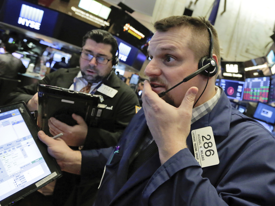 Trader Michael Milano (right) on the floor of the New York Stock Exchange on Thursday, a day when all the major U.S. stock indexes saw sharp drops. (Richard Drew/AP)