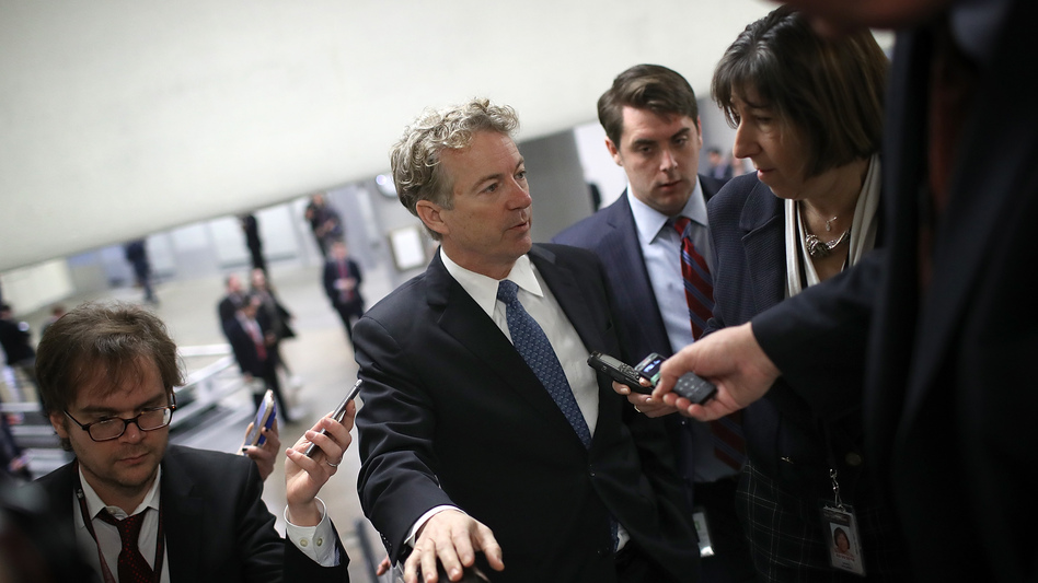 Sen. Rand Paul, R-Ky., speaks with reporters Thursday on his way to a vote on the Senate floor. (Win McNamee/Getty Images)