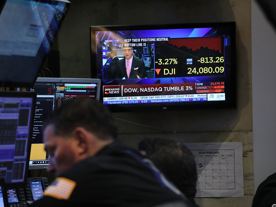 Traders work on the floor of the New York Stock Exchange moments before the Closing Bell on Feb. 8 in New York City. (Spencer Platt/Getty Images)