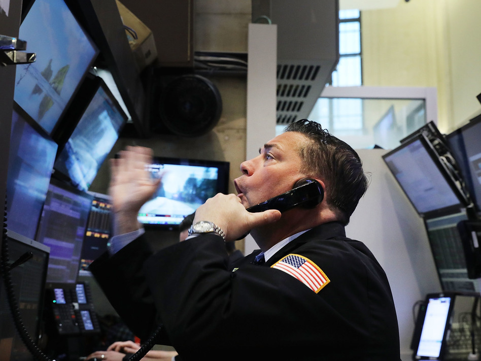 It's been a volatile week on the floor of the New York Stock Exchange, and Friday was no exception. (Spencer Platt/Getty Images)