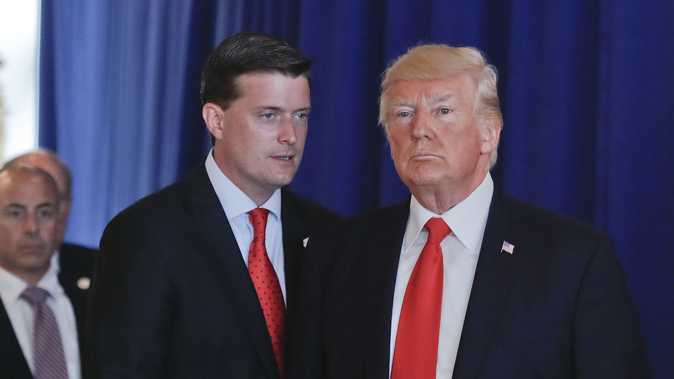 Ousted White House staff secretary Rob Porter speaks to President Trump after remarks he made on violence in Charlottesville, Va., in August 2017 at Trump National Golf Club in Bedminister, N.J. (Pablo Martinez Monsivais/AP)