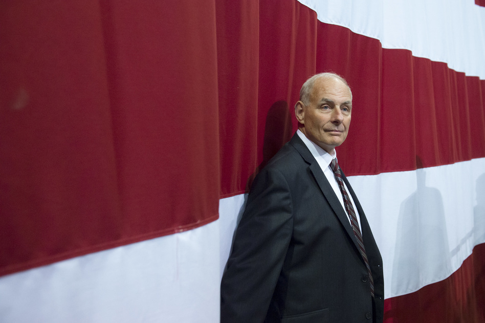 White House chief of staff John Kelly listens as President Trump speaks during a rally in Huntington, W.Va. on August 3, 2017. (Saul Loeb/AFP/Getty Images)