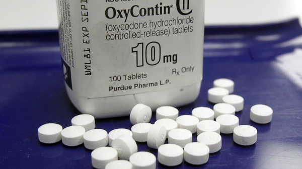 OxyContin pills arranged for a photo at a pharmacy in Montpelier, Vt. in a photo taken in 2013.
