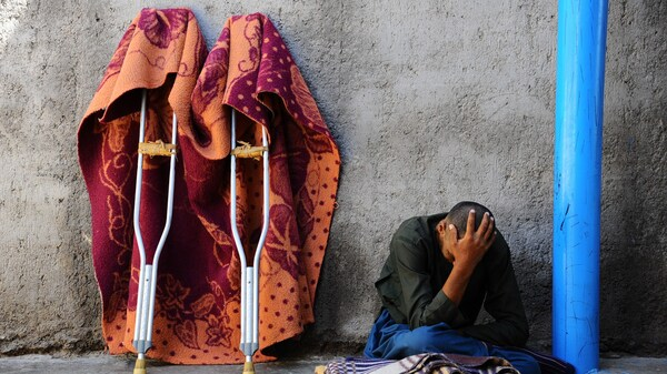 An Afghan patient sits in a yard at the only mental health rehabilitation center in the city of Herat in April 2014.