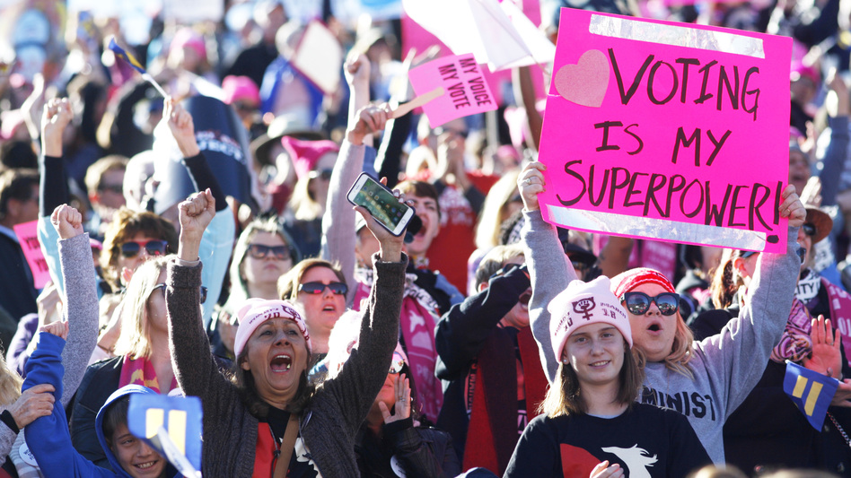 "Participants cheer a speaker during the Women's March ""Power to the Polls"" voter registration tour launch at Sam Boyd Stadium in Las Vegas on Jan. 21. (Sam Morris/Getty Images)"