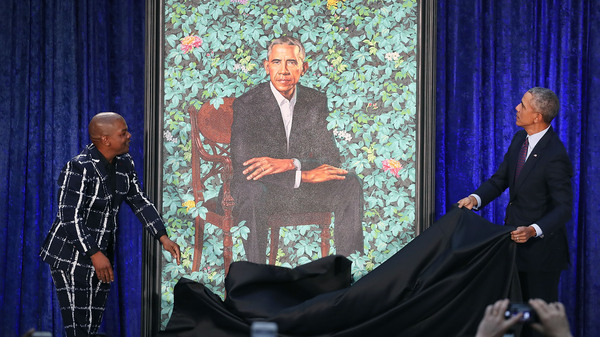 Former President Barack Obama and artist Kehinde Wiley unveil his portrait during a ceremony at the Smithsonian