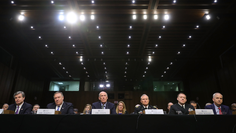 FBI Director Christopher Wray (from left), CIA Director Mike Pompeo, Director of National Intelligence Dan Coats, Defense Intelligence Agency Director Lt. Gen. Robert Ashley, NSA Director Adm. Michael Rogers and National Geospatial-Intelligence Agency Director Robert Cardillo testify before the Senate intelligence committee on Tuesday. (Chip Somodevilla/Getty Images)