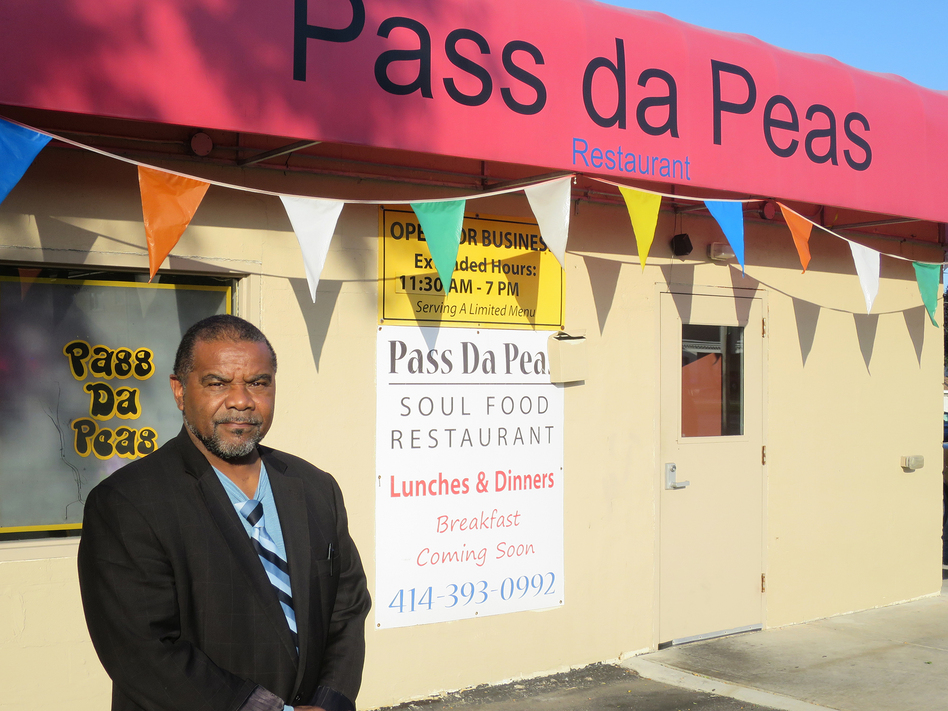 Thromentta Anderson, the owner of Pass Da Peas in northwest Milwaukee likes to greet customers by name and give them tokens toward free drinks. But he was glad to see new faces during Black Restaurant Week. (Alan Greenblatt for NPR)