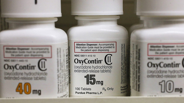 Bottles of Purdue Pharma L.P. OxyContin medication sit on a pharmacy shelf in Provo, Utah, in 2016.