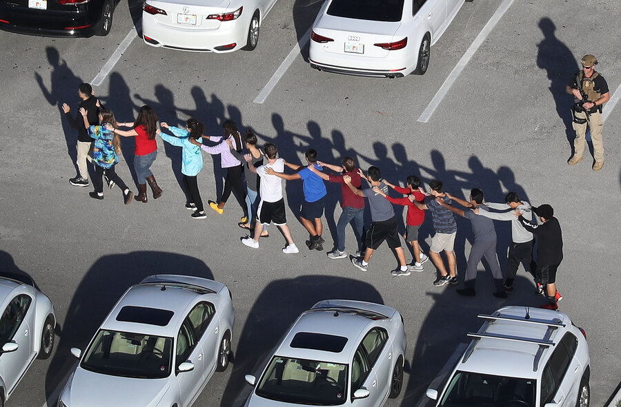 People Are Brought Out Of Marjory Stoneman Douglas High School In Parkland Fla