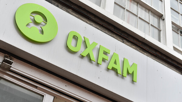 An Oxfam sign outside one of its charity shops in central London, where they sell secondhand goods to raise funds.