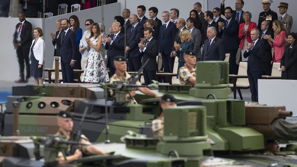 Tanks parade past (front row, center from left) first lady Melania Trump, President Trump, French President Emmanuel Macron and his wife, Brigitte Macron, during the Bastille Day celebrations in July in Paris.