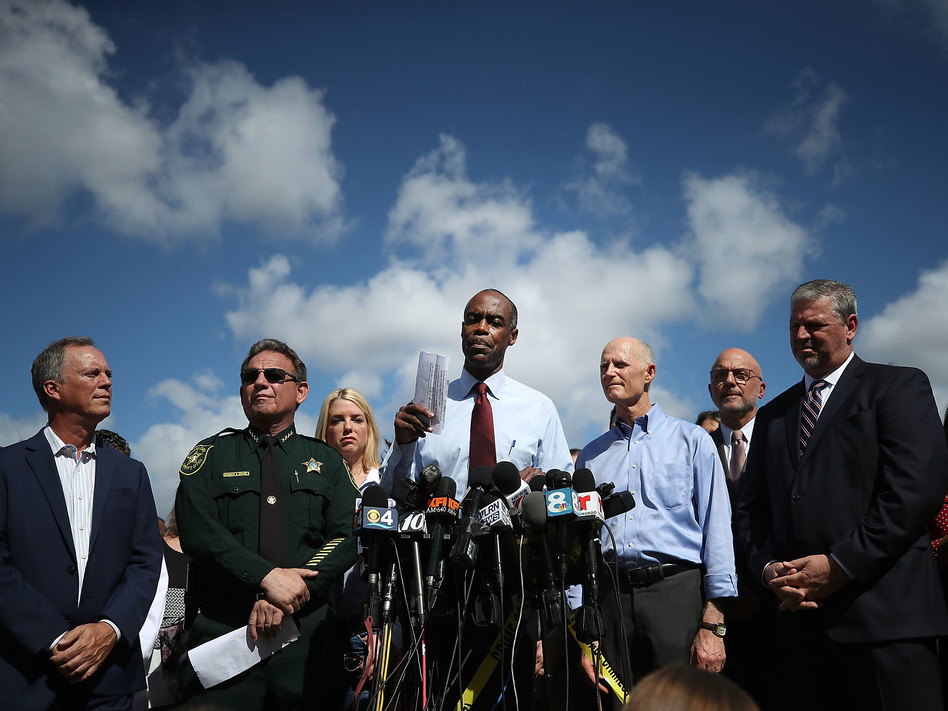 Broward County Public Schools Superintendent Robert Runcie speaks at a news conference Thursday, as county Mayor Beam Furr (from left), Broward Sheriff Scott Israel, Gov. Rick Scott and FBI agent Robert Lasky look on. (Mark Wilson/Getty Images)