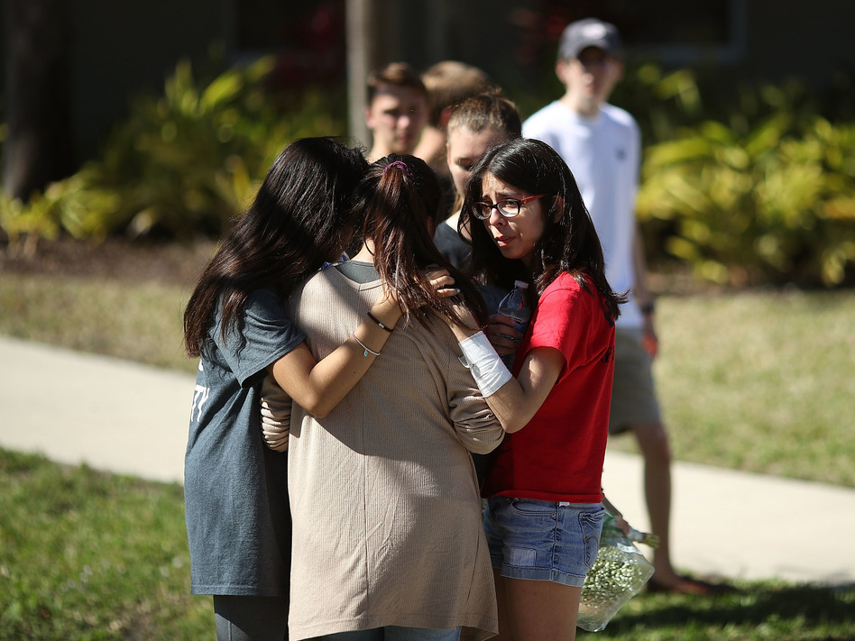 Students of Marjory Stoneman Douglas High School gather on Thursday in Parkland, Fla. Fourteen students and three staff members were killed in a shooting at the school on Wednesday. (Mark Wilson/Getty Images)