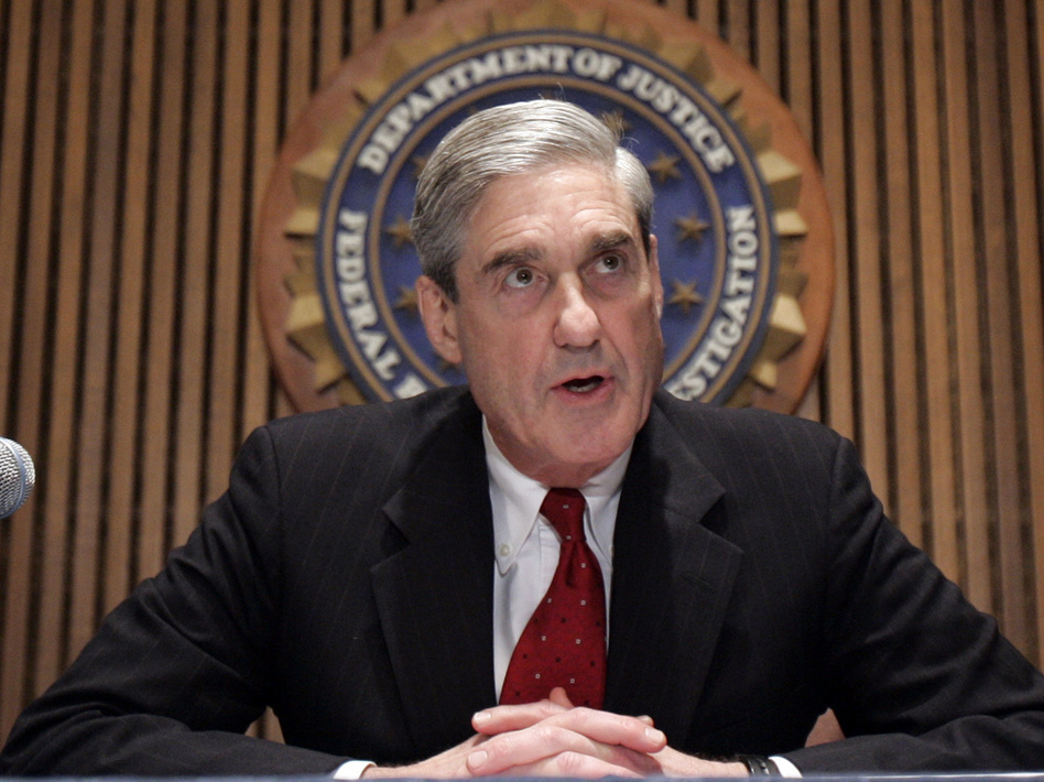 The office of Justice Department special counsel Robert Mueller says 13 Russians and three Russian entities took part in a broad information war against the United States. (Susan Walsh/AP)