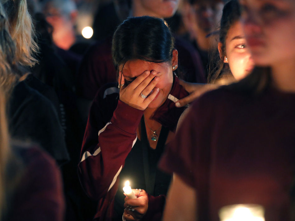 A woman cries during a candlelight vigil for the victims of Wednesday's shooting at Marjory Stoneman Douglas High School, in Parkland, Fla. (Gerald Herbert/AP)