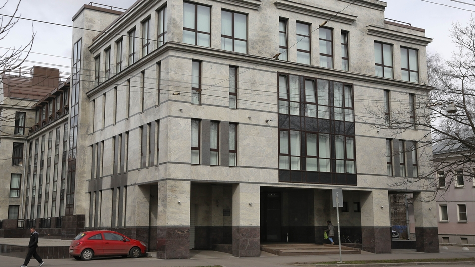 "In this file photo taken on April 19, 2015, a women enters the four-story building known as the ""troll factory"" in St. Petersburg, Russia. The U.S. government alleges the Internet Research Agency started interfering as early as 2014 in U.S. politics, extending to the 2016 presidential election. (Dmitry Lovetsky/AP)"