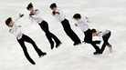 A multiple exposure image shows a portion of the free skate by Japan's Yuzuru Hanyu, the first man to repeat as Olympics figure skating champion since 1952.