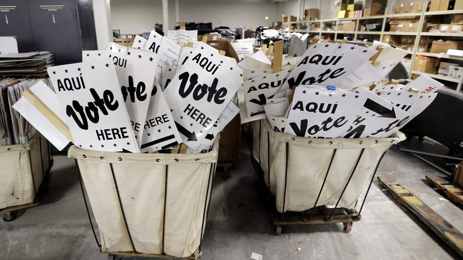 Bins of signs are seen at an election office in San Antonio, Texas. The first primaries of the 2018 elections are less than a month away, and the Department of Homeland Security held a classified briefing last week to further explain voter system threats to election directors and secretaries of state. (Eric Gay/AP)