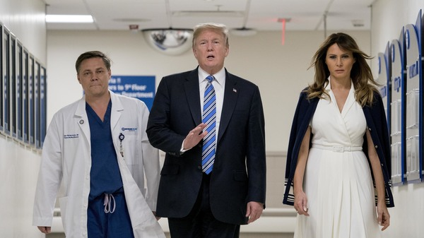 President Trump, accompanied by first lady Melania Trump, right, and Dr. Igor Nichiporenko speak to reporters while visiting with medical staff at Broward Health North in Pompano Beach, Fla., Friday.