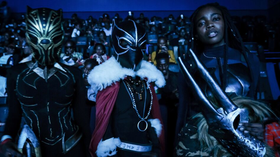 Costumed viewers pose before watching <em>Black Panther</em> in Nairobi, Kenya, on Wednesday. (Yasuyoshi Chibe/AFP/Getty Images)