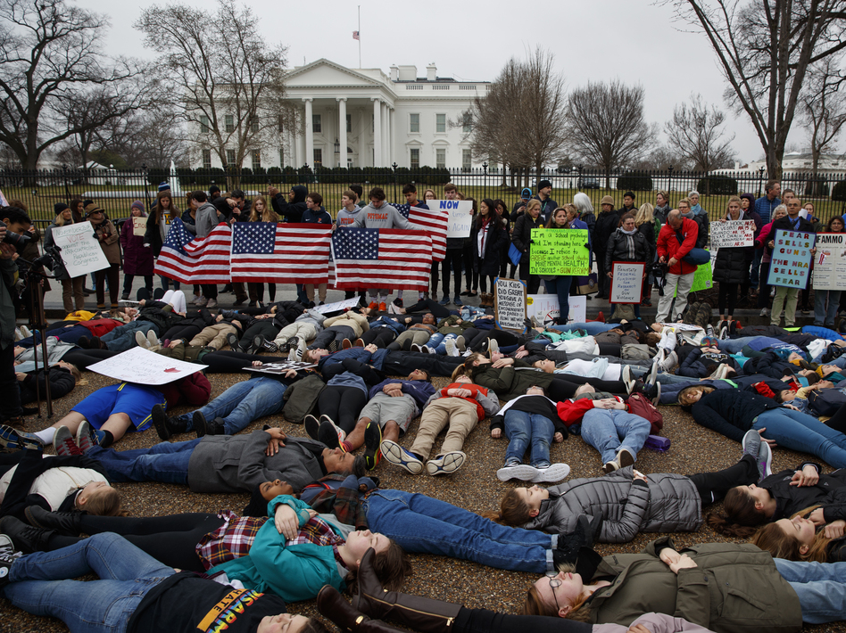 "Demonstrators participate in a ""lie-in"" during a protest in favor of gun control reform in front of the White House. Grassroots groups are planning hundreds more protests in coming weeks. (Evan Vucci/AP)"