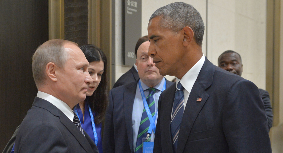 Russian President Vladimir Putin speaks with then-President Barack Obama in Hangzhou, China, on Sept. 5, 2016. Obama's warnings about active measures went unheeded. (Alexei Druzhinin/AP)