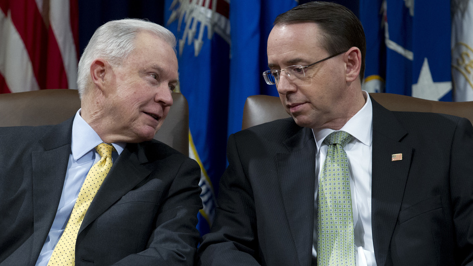 Attorney General Jeff Sessions speaks with Deputy Attorney General Rod Rosenstein at an event at the Department of Justice in Washington, D.C. on Feb. 2, 2018. (Jose Luis Magana/AP)