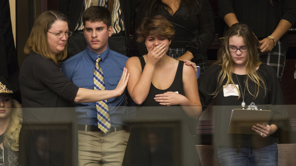 High school students from Parkland, Fla., where a young man gunned down 17 people, react as the state
