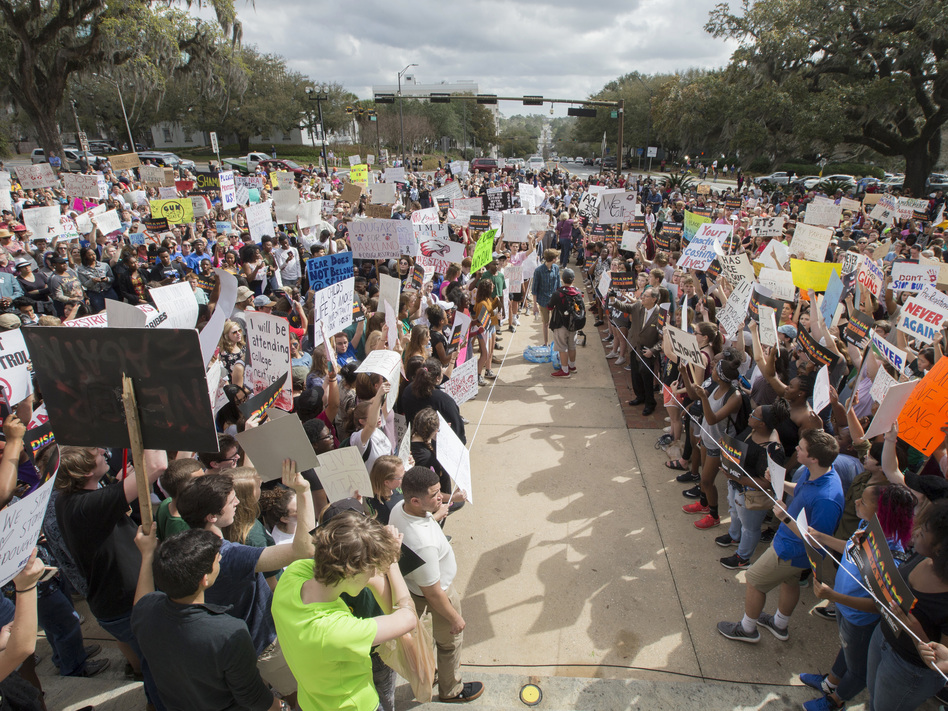 Students gather on the steps of the old Florida Capitol in Tallahassee, Fla., protesting for stricter gun laws on Wednesday. Students at schools across Broward and Miami-Dade counties in South Florida also planned short walkouts in support. (Mark Wallheiser/AP)