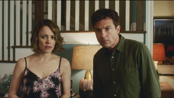 In Game Night, Annie (Rachel McAdams) and Max (Jason Bateman) spend a night as pawns in someone else