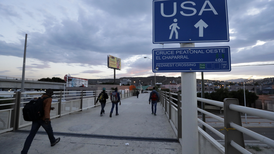 Immigrants make their way towards the border crossing in Tijuana, Mexico. (Gregory Bull/AP)