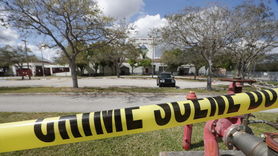 Crime scene tape runs outside Marjory Stoneman Douglas High School in Parkland, Fla., on  Sunday, Feb. 18., a few days after the shooting that left 17 people dead. (Gerald Herbert/AP)