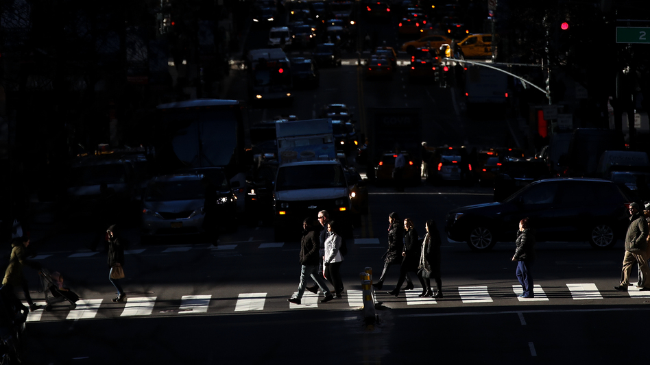 Pedestrians cross the street as traffic moves along 42nd Street in Midtown Manhattan on Jan. 25. (Drew Angerer/Getty Images)