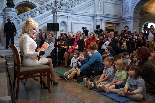Dolly Parton reads Coat of Many Colors, a children's book based on one of her signature songs, to a group of children at the Great Hall of the Library of Congress in Washington, D.C., on Tuesday.