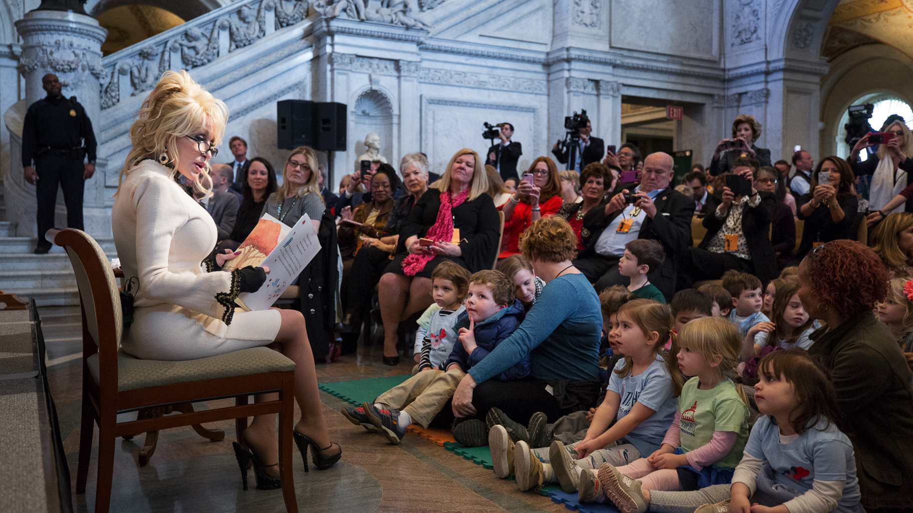 Dolly Parton donates her 100 millionth book for charity