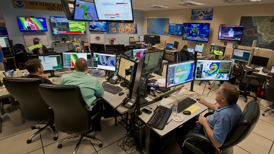 Forecasters at the National Weather Service office monitor Hurricane Irma on Sept. 9, 2017, at the hurricane center in Miami. (Andy Newman/AP)