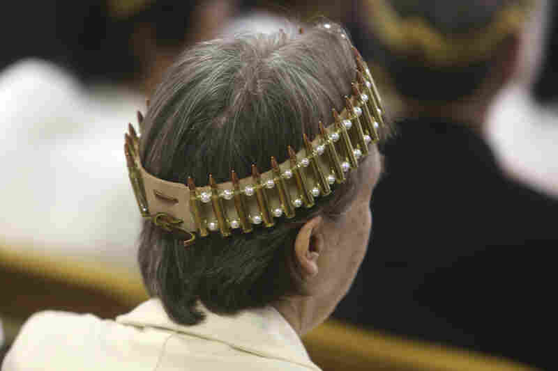 A woman wears a crown made of ammunition during services at the World Peace and Unification Sanctuary on Wednesday.
