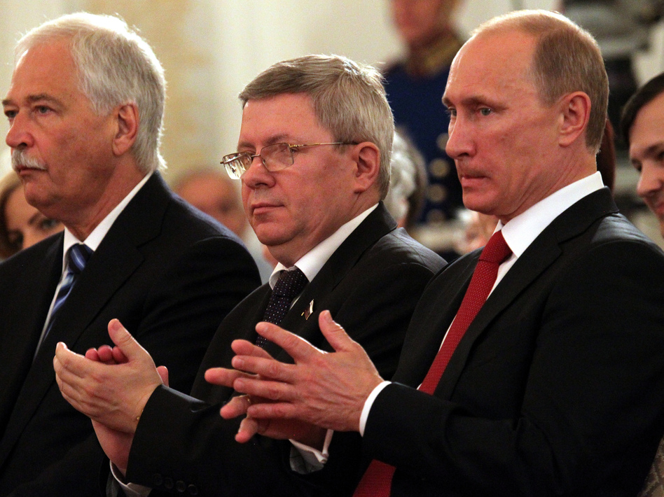 Russian politician Alexander Torshin, standing next to then-Russian Prime Minister Vladimir Putin, attends a ceremony at the Kremlin in 2011. Torshin is a lifetime member of the National Rifle Association and says he met Donald Trump through the group in 2015. (Konstantin Zavrazhin/Getty Images)