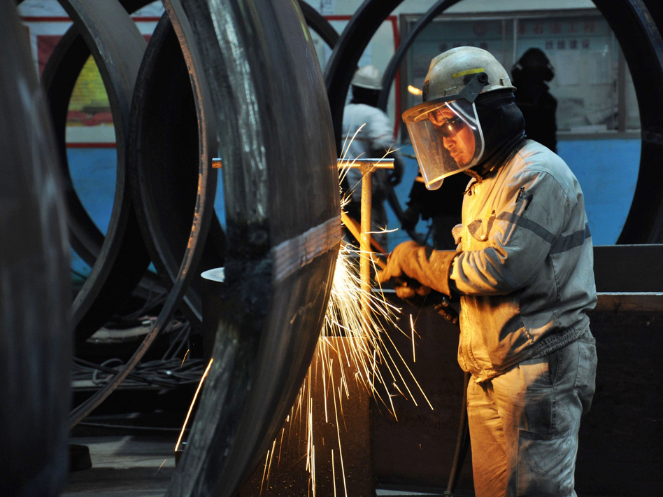 A worker cuts steel in Qingdao in China's eastern Shandong province. President Trump said Thursday that he plans to impose tariffs on U.S. imports of steel and aluminum. (AFP/Getty Images)