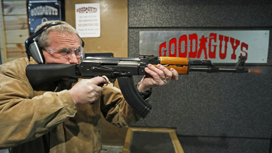 Vince Warner fires an AK-47 with a bump stock installed at Good Guys Gun and Range in Utah. A significant majority of Americans favor outlawing the attachment, according to the latest NPR/Ipsos poll. (George Frey/Getty Images)
